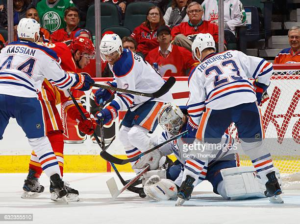 Laurent Brossoit of the Edmonton Oilers tracks the puck through a crowd against the Calgary Flames at Scotiabank Saddledome on January 21 2017 in...