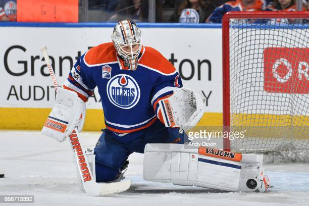 Laurent Brossoit of the Edmonton Oilers warms up prior to the game against the Minnesota Wild on January 31 2017 at Rogers Place in Edmonton Alberta...