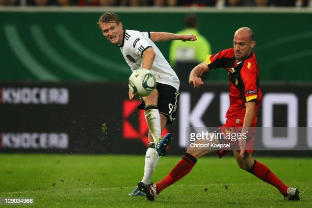 Laurent Ciman of Belgium challenges Andre Schuerrle of Germany during the UEFA EURO 2012 Group A qualifying match between Germany and Belgium at...