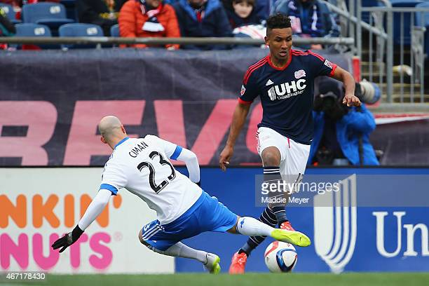 Laurent Ciman of Montreal Impact slides into Juan Agudelo of New England Revolution during the second half at Gillette Stadium on March 21 2015 in...