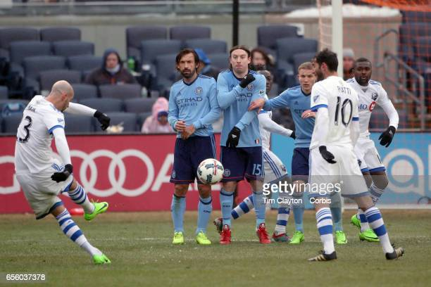 Laurent Ciman of Montreal Impact takes a free kick during the New York City FC Vs Montreal Impact regular season MLS game at Yankee Stadium on March...
