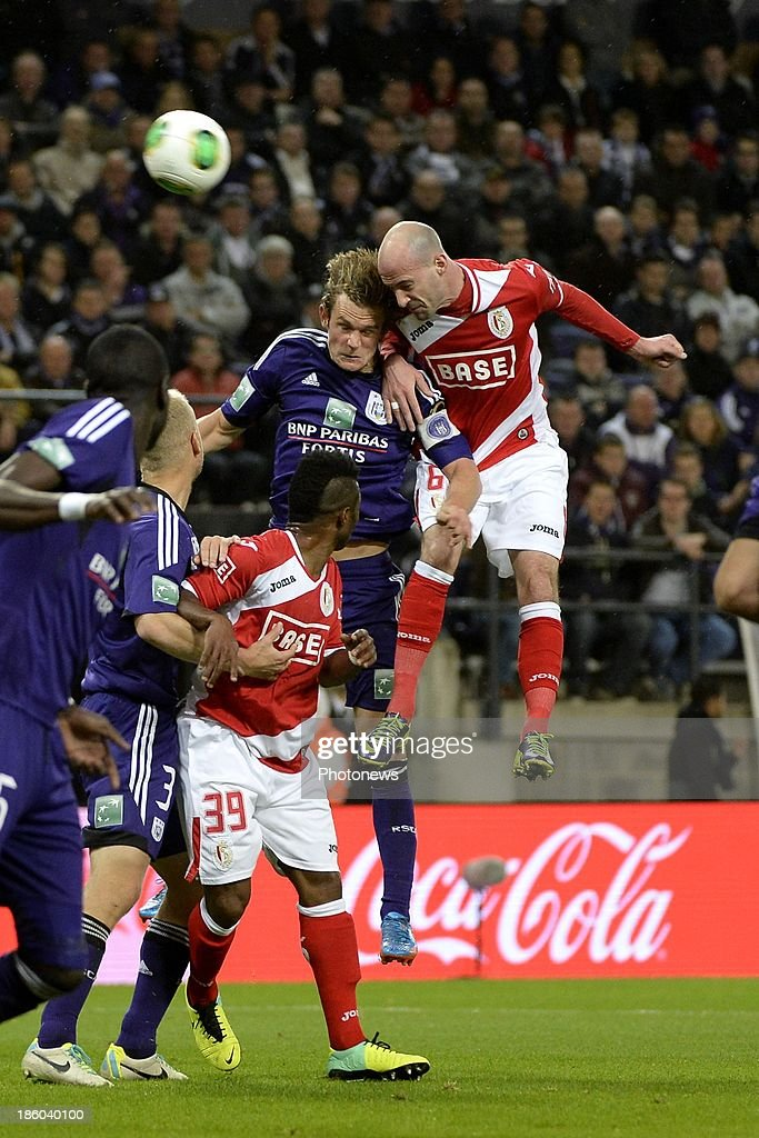 Laurent Ciman of Standard and Guillaume Gillet of RSC Anderlecht during the Jupiler League match between RSC Anderlecht and Standard Liege on October 27, 2013 in Anderlecht, Belgium.