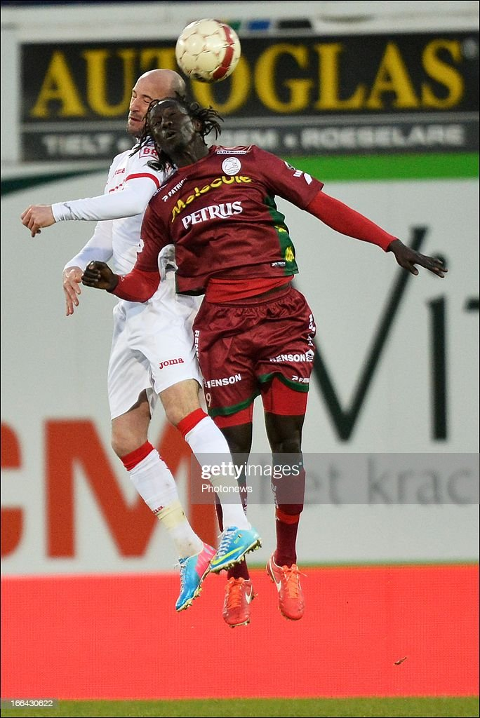 Laurent Ciman of Standard battles for the ball with Mbaye Leye of Zulte-Waregem during the Jupiler League match play-off 1 between Zulte Waregem and Standard de Liege on April 12, 2013 in Waregem, Belgium.