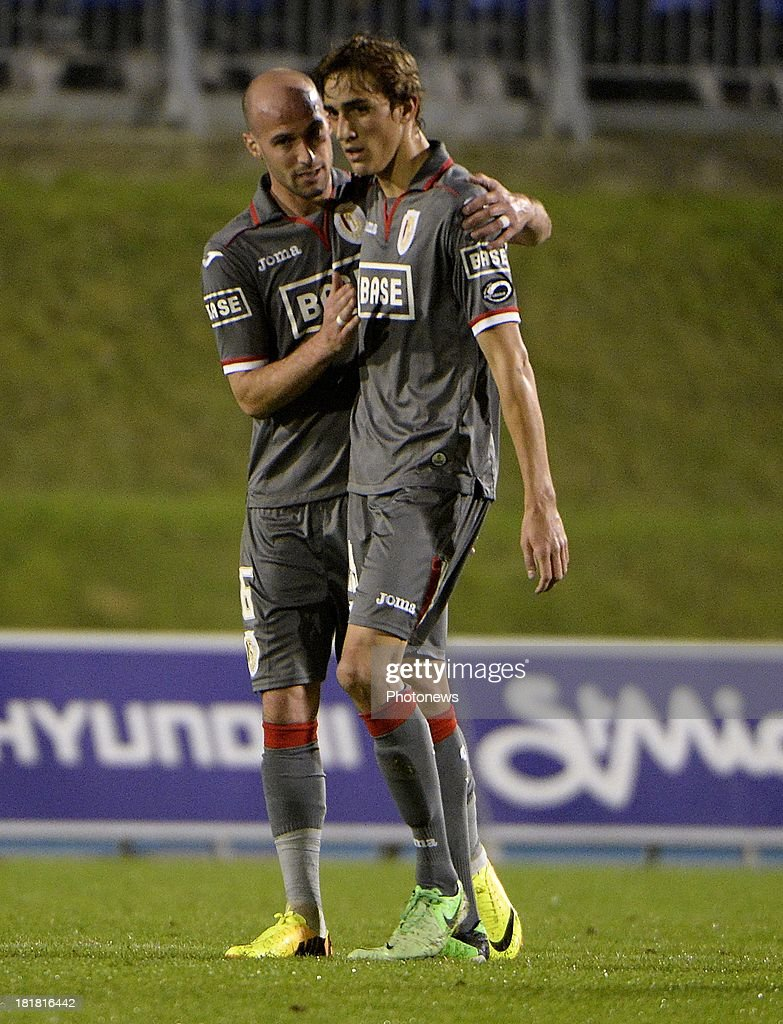 Laurent Ciman of Standard Liege and Julien De Sart of Standard Liege pictured during the Cofidis Cup match between White Star and Standard of Liege on september 25 , 2013 in Woluwe, Belgium.