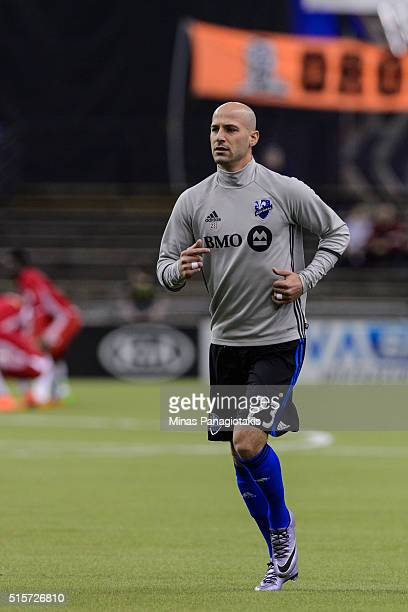 Laurent Ciman of the Montreal Impact runs during the warmup prior to the MLS game against the New York Red Bulls at the Olympic Stadium on March 12...