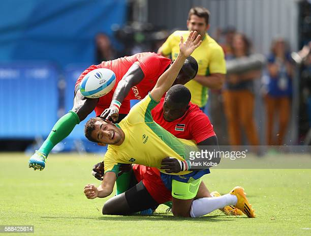 Laurent Couhet of Brazil loses the ball as he is tackled by Collins Injera of Kenya during the Men's Rugby Sevens placing 1112 match between Brazil...