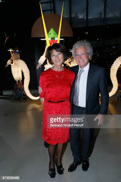 Laurent Dassault and his wife Martine pose in front the works of JeanPaul Goude during the 'Societe des Amis du Musee d'Art Moderne du Centre...