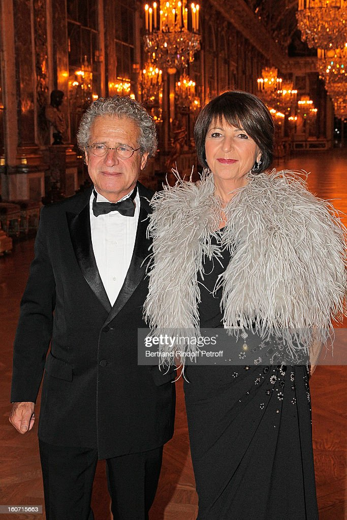 Laurent Dassault (L) and his wife Martine pose in the Hall of Mirrors as they attend the gala dinner of Professor David Khayat's association 'AVEC', at Chateau de Versailles on February 4, 2013 in Versailles, France.