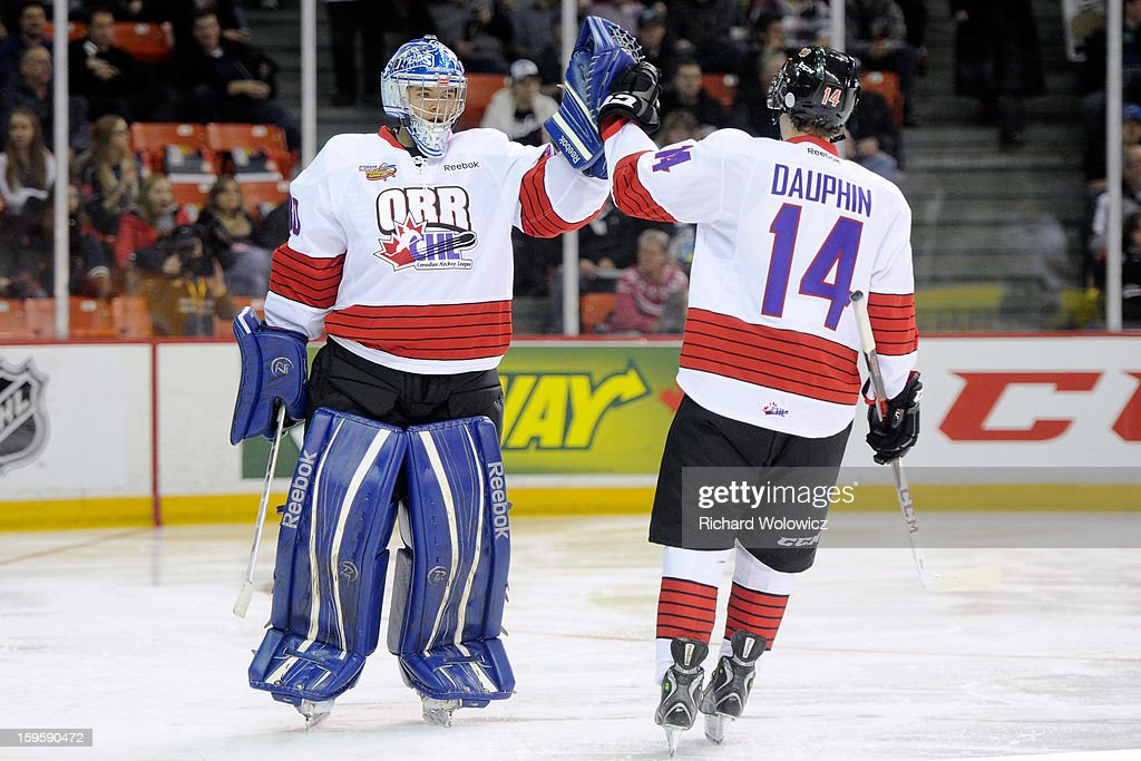 Laurent Dauphin #14 of Team Orr celebrates his second period goal with teammate Spencer Martin #30 during the CHL Top Prospects game Team Cherry at the Halifax Metro Centre on January 16, 2013 in Halifax, Nova Scotia, Canada. Team Orr defeated Team Cherry 3-0.