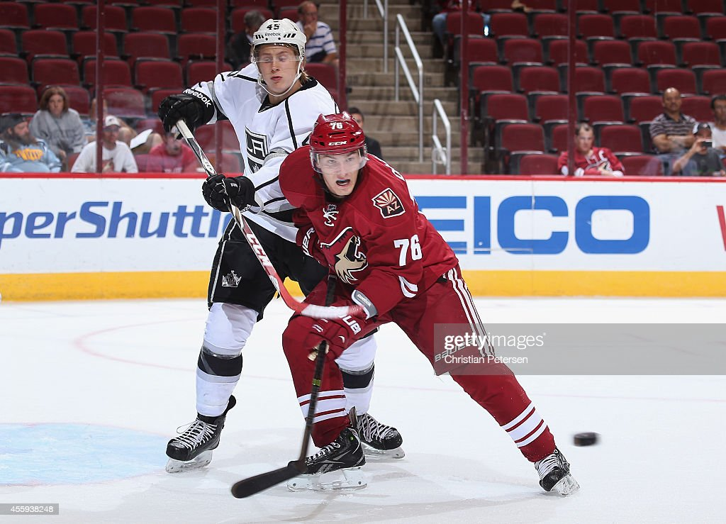 Laurent Dauphin #76 of the Arizona Coyotes battles for positon with Alex Lintuniemi #45 of the Los Angeles Kings during the NHL rookie camp game at Gila River Arena on September 16, 2014 in Glendale, Arizona.