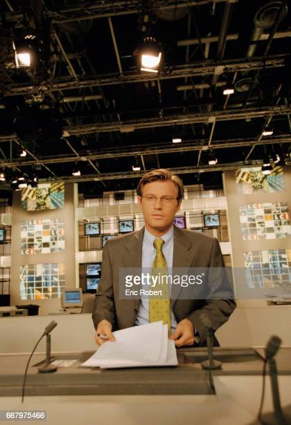 Laurent Delahousse broadcasts a news report from the studio of French television station LCI Delahousse is the anchor for LCI a 24 hour cable news...
