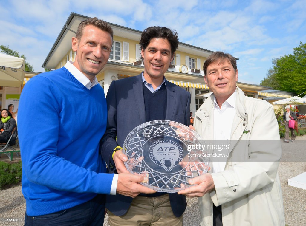 Laurent Delanney, ATP CEO Europe presents Tournament Director, Patrik Kuhnen and Fabian Tross, Managing Director Iphitos Club with an award for being a part of the ATP World Tour for 25 years during the BMW Open on April 29, 2014 in Munich, Germany.