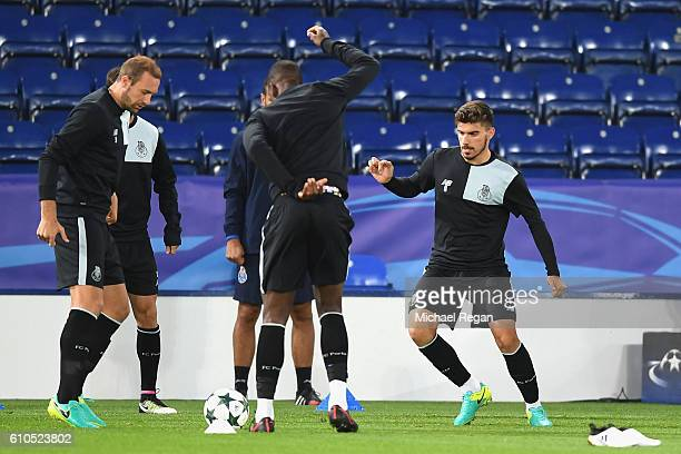 Laurent Depoitre of FC Porto and Ruben Neves of FC Porto warm up with team mates during a FC Porto Training Session and Press Conference ahead of...