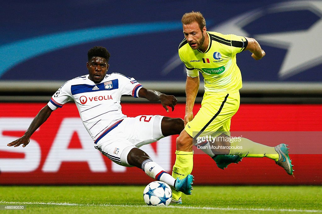 Laurent Depoitre of Gent battles for the ball with <a gi-track='captionPersonalityLinkClicked' href=/galleries/search?phrase=Samuel+Umtiti&family=editorial&specificpeople=7123899 ng-click='$event.stopPropagation()'>Samuel Umtiti</a> of Lyon during the UEFA Champions League Group H match between KAA Gent and Olympique Lyonnais held at Ghelamco Arena on September 16, 2015 in Gent, Belgium.