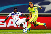 Laurent Depoitre of Gent battles for the ball with Samuel Umtiti of Lyon during the UEFA Champions League Group H match between KAA Gent and...