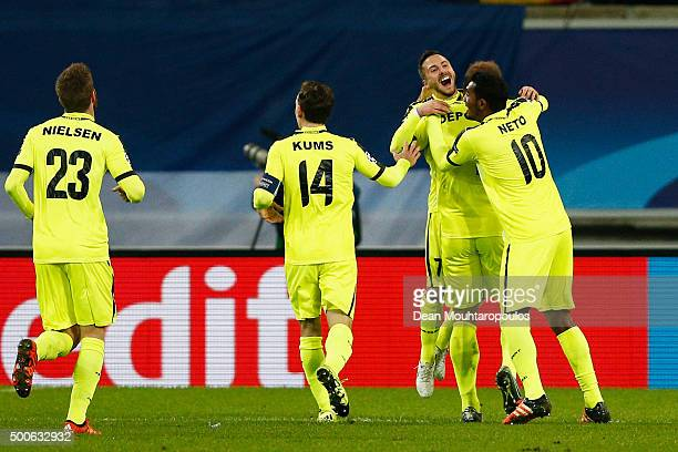 Laurent Depoitre of Gent celebrates scoring his teams first goal of the game with teammates during the group H UEFA Champions League match between...