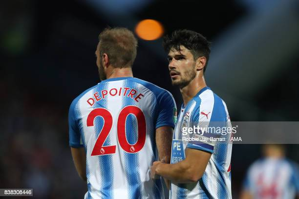 Laurent Depoitre of Huddersfield Town and Christopher Schindler of Huddersfield Town during the Carabao Cup Second Round match between Huddersfield...