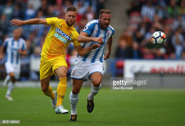 Laurent Depoitre of Huddersfield Town in action with Silvan Widmer of Udinese during the pre season friendly match between Huddersfield Town and...