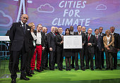 Laurent Fabius France's foreign minister left Anne Hidalgo mayor of Paris center Ban Kimoon secretarygeneral of the United Nations center right and...