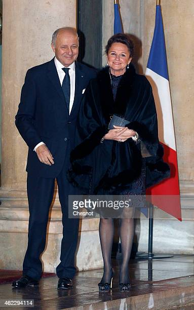 Laurent Fabius French Minister of Foreign Affairs and International Development and his companion MarieFrance Marchand baylet arrives for a official...