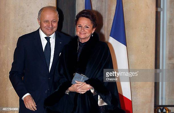 Laurent Fabius French Minister of Foreign Affairs and International Development and his companion MarieFrance Marchand Baylet arrive for a official...