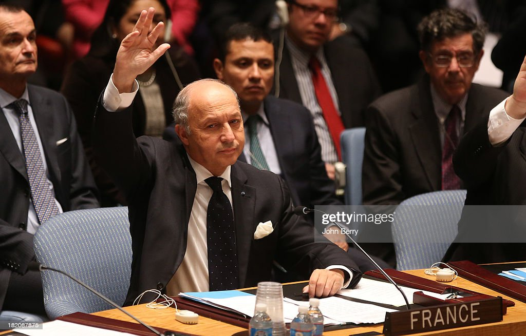 <a gi-track='captionPersonalityLinkClicked' href=/galleries/search?phrase=Laurent+Fabius&family=editorial&specificpeople=540660 ng-click='$event.stopPropagation()'>Laurent Fabius</a>, Minister for Foreign Affairs of France votes on a resolution regarding Syria's chemical weapons program at a Security Council's meeting aside the 68th United Nations General Assembly on September 27, 2013 in New York City.
