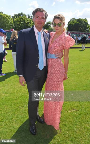 Laurent Feniou and Jessica Hart attend the Cartier Queen's Cup Polo final at Guards Polo Club on June 18 2017 in Egham England