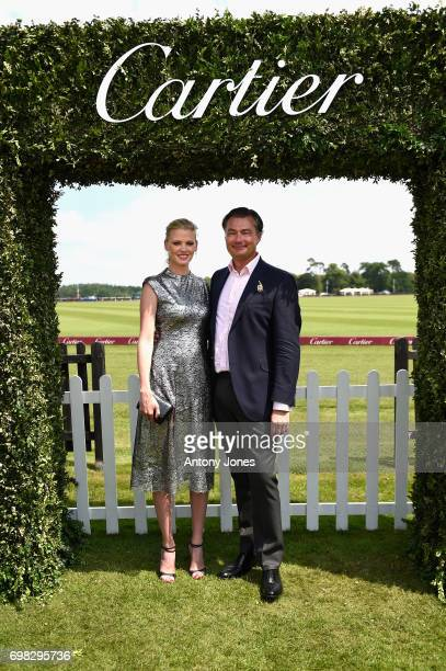 Laurent Feniou and Lara Stone attend the Cartier Queen's Cup Polo at Guards Polo Club on June 18 2017 in Egham England 2