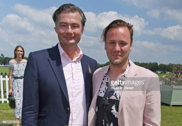 Laurent Feniou and Nicholas Kirkwood attend the Cartier Queen's Cup Polo final at Guards Polo Club on June 18 2017 in Egham England