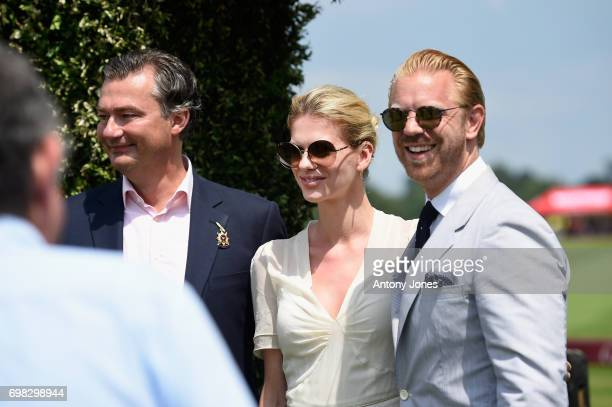 Laurent Feniou Barbora Bediova and Alistair Guy attend the Cartier Queen's Cup Polo at Guards Polo Club on June 18 2017 in Egham England 2