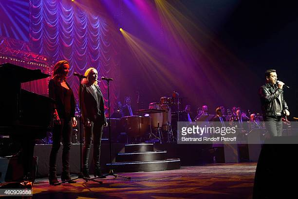 Laurent Gerra imitates singer Johnny Hallyday with his Chorus Singer Salome Stevenin and Christaline during the Laurent Gerra Show at Palais des...