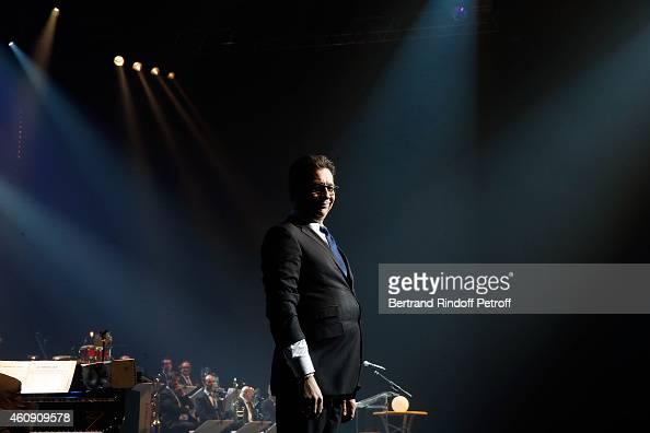 Laurent Gerra imitates the French President Francois Hollande during the Laurent Gerra Show at Palais des Sports on December 26 2014 in Paris France