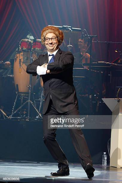 Laurent Gerra imitates the French President Francois Hollande during the Laurent Gerra Show at Palais des Sports on December 25 2014 in Paris France