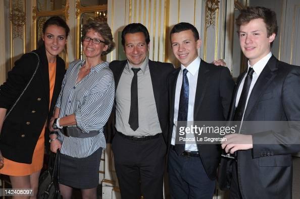 Laurent Gerra poses with Alexia Valerie Constentin and Benjamin Rindoff Petroff at Ministere de la Culture on April 4 2012 in Paris France