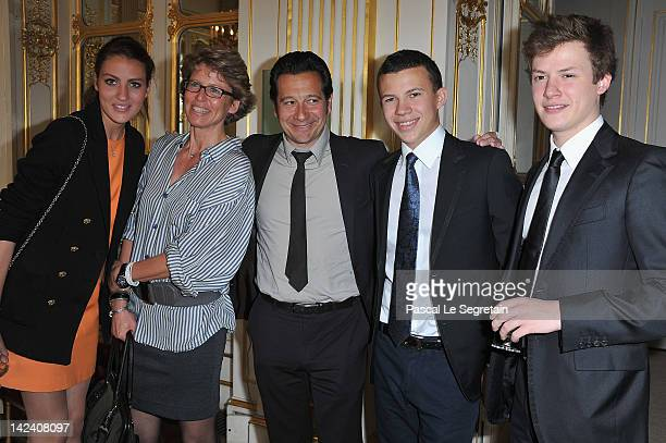 Laurent Gerra poses with Alexia Valerie Constentin and Benjamin Rindoff Petroff at Ministere de la Culture on April 4 2012 in Paris France