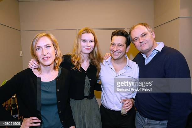 Laurent Gerra standing with Director Christian Carion his wife Sophie Carion and their daughter Laurence Carion pose backstage following the show of...