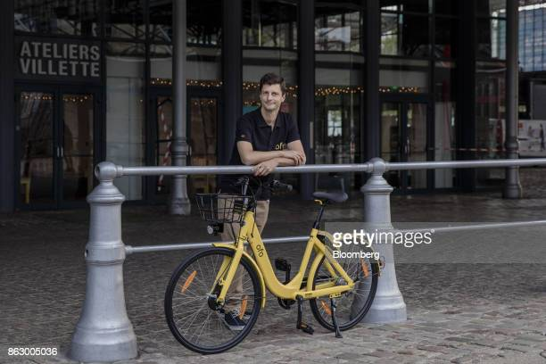 Laurent Kennel general manager of France at Ofo Inc poses for a photograph beside a Ofo hire bicycle at the Autonomy urban mobility summit in Paris...