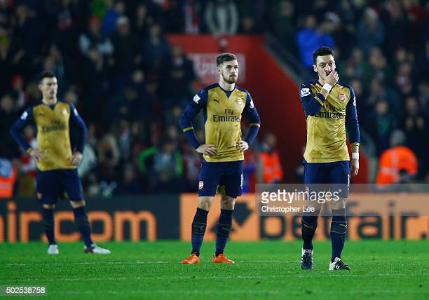 Laurent Koscielny Aaron Ramsey and Mesut Ozil of Arsenal look dejected during the Barclays Premier League match between Southampton and Arsenal at St...