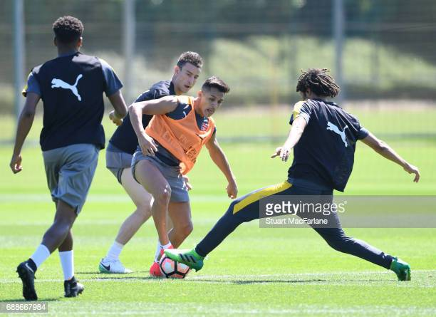 Laurent Koscielny Alexis Sanchez and Mohamed Elneny of Arsenal during a training session at London Colney on May 26 2017 in St Albans England
