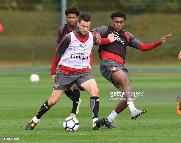 Laurent Koscielny and Alex Iwobi of Arsenal during a training session at London Colney on October 21 2017 in St Albans England