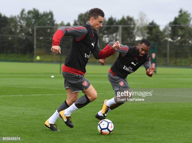 Laurent Koscielny and Alex Lacazette of Arsenal during a training session at London Colney on August 2 2017 in St Albans England