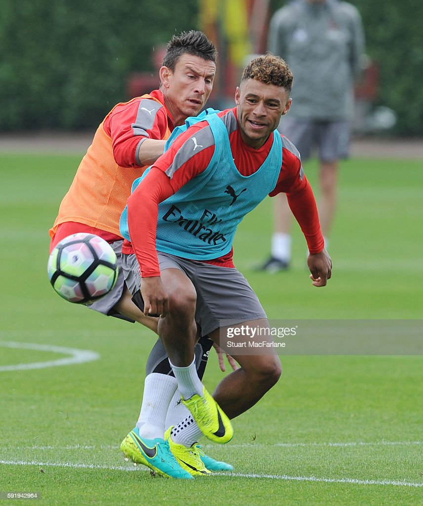 Laurent Koscielny and Alex OxladeChamberlain of Arsenal during a training session at London Colney on August 19 2016 in St Albans England