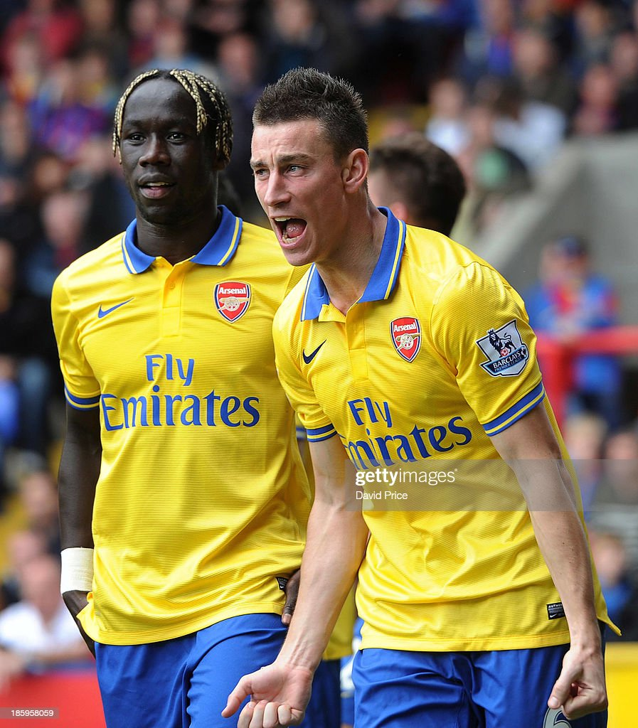 <a gi-track='captionPersonalityLinkClicked' href=/galleries/search?phrase=Laurent+Koscielny&family=editorial&specificpeople=2637418 ng-click='$event.stopPropagation()'>Laurent Koscielny</a> (R) and <a gi-track='captionPersonalityLinkClicked' href=/galleries/search?phrase=Bacary+Sagna&family=editorial&specificpeople=745680 ng-click='$event.stopPropagation()'>Bacary Sagna</a> celebrate after their team's second goal is scored during the match between Crystal Palace and Arsenal at Selhurst Park on October 26, 2013 in London, England.