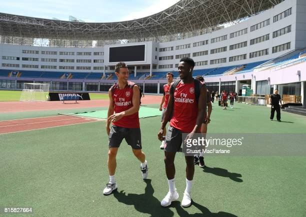 Laurent Koscielny and Danny Welbeck of Arsenal before a training session at the Yuanshen stadium in Shanghi on July 17 2017 in Shanghai China