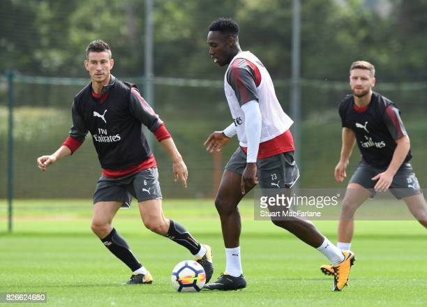 Laurent Koscielny and Danny Welbeck of Arsenal during a training session at London Colney on August 5 2017 in St Albans England