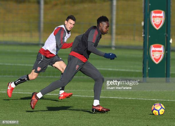 Laurent Koscielny and Danny Welbeck of Arsenal during a training session at London Colney on November 17 2017 in St Albans England