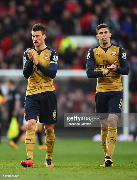 Laurent Koscielny and Gabriel Paulista of Arsenal look dejected after the Barclays Premier League match between Manchester United and Arsenal at Old...