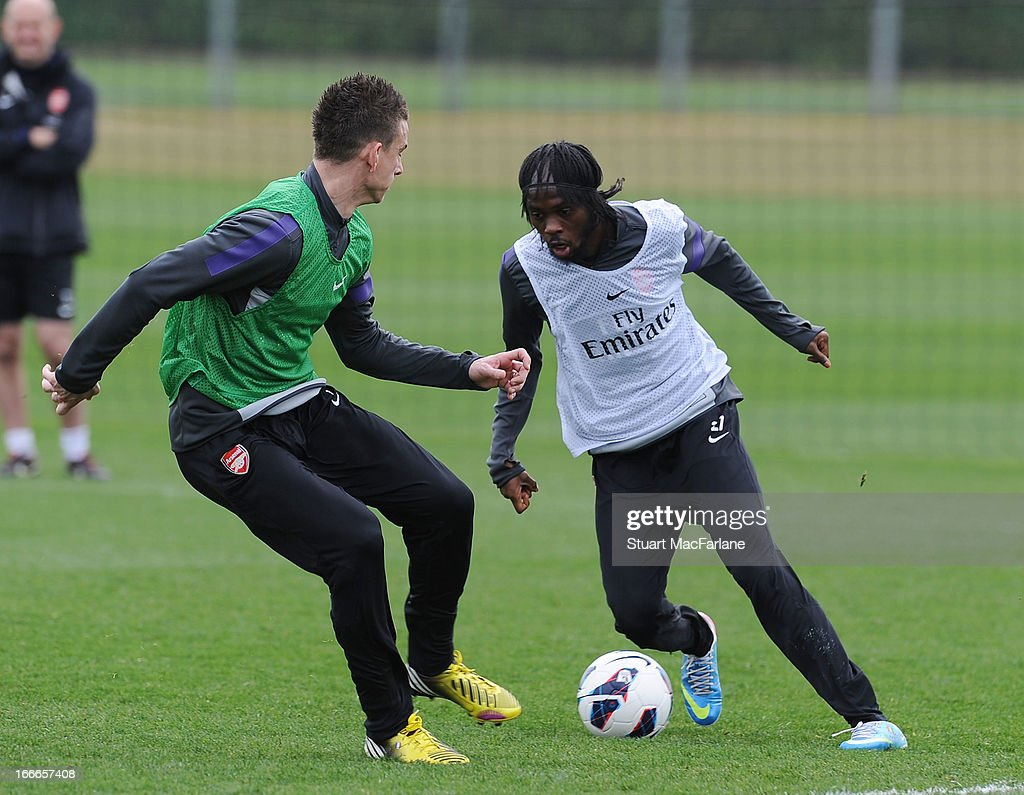 Laurent Koscielny and Gervinho of Arsenal during a training session at London Colney on April 15, 2013 in St Albans, England.