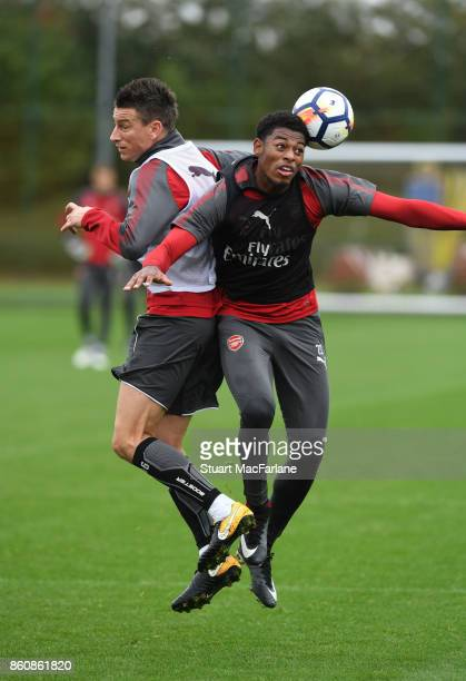 Laurent Koscielny and Jeff ReineAdelaide of Arsenal during a training session at London Colney on October 13 2017 in St Albans England