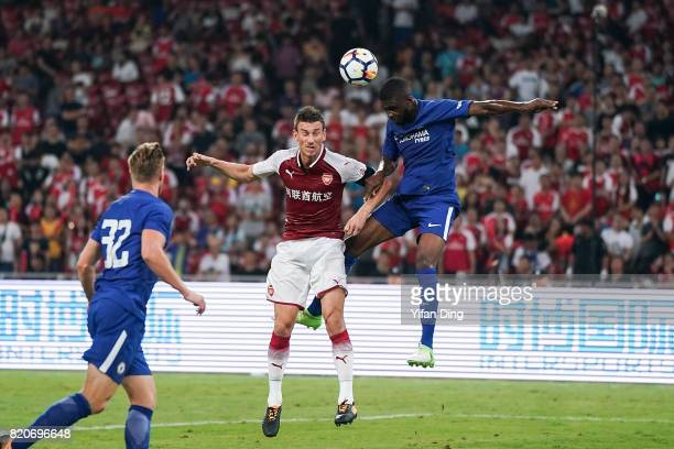 Laurent Koscielny and Jeremie Boga fight for the ball during the PreSeason Friendly match between Arsenal FC and Chelsea FC at Birds Nest on July 22...